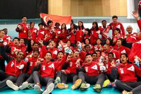 DESERVING CHAMPIONS: Singapore floorball players (in red and white) didn't disappoint fans with their exciting finish to both finals.