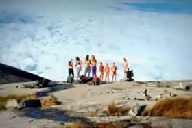 A picture of the group of tourists who caused an uproar posing naked on top of Mount Kinabalu.
