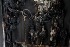 BURNT: The electrical box of Dapur Penyet at 23 Baghdad Street was burnt in a fire which started from its neighbouring unit.