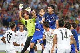 HEROES: Playmaker Chanathip Songkrasin is the standout player for Thailand at the SEA Games while Myanmar goalkeeper Phyo Kyaw Zin (above in yellow) helps his team from suffering a heavier defeat.