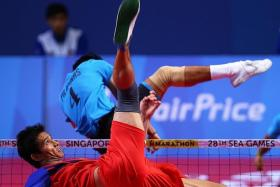 MIGHTY MYANMARESE: (Above) Latt Zaw executes an acrobatic return against the Philippines.