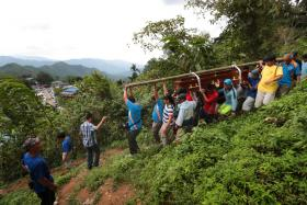The many guides who volunteered for the search and rescue operation, which involved carrying bodies down the mountain when the earthquake hit Mount Kinabalu in Sabah on June 5, 2015.