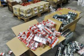 A total of 2,999 cartons and seven packets of duty unpaid cigarettes were seized, some of which were smuggled in via bed headboards.