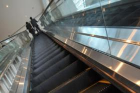 The boy was on the escalator when his hand got caught and was severed at the wrist. Rescuers recovered the severed hand two hours later.