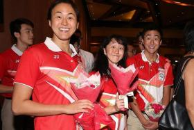 THREE CHEERS: (Left to right) The Quah siblings Ting Wen, Jing Wen and Zheng Wen after receiving a bouquet of flowers each to present to their parents at last night's SSA celebratory dinner.