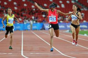 GOLDEN GIRL: Shanti Pereira (No. 212) winning the 200m on June 10, Singapore's first women's sprint gold for 42 years.