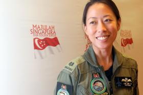 WOMAN FIGHTER PILOT: Major Lee Mei Yi.