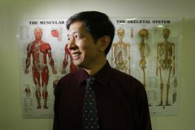 SAVING LIVES: Dr Patrick Goh has tended to five midair medical emergencies over the past 21 years.