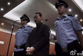 Tian Fusheng (middle) has denied that he cheated the 15 women by claiming that they gave him money voluntarily.