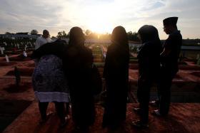 Mr Ghazi's family members bidding him a last goodbye.