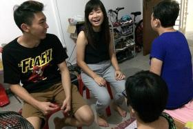 SUPPORT: Miss Mary Nguyen Thi Hong Van visiting Mr Lu Zhi Quan, his mother and sister at the family's one-room rental flat in Sengkang.