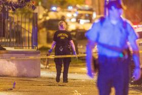 Police investigate the scene of a shooting along Ogden Street in Philadelphia, United States.