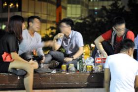 Bottoms up: Young people drinking on Read Bridge in Clarke Quay in 2012.