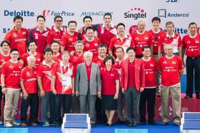 WINNERS: (Above) Former water polo players, who represented Singapore from 1965 to 2013 at the SEA Games, with President Tony Tan, his wife Mary and Minister for Culture, Community and Youth Lawrence Wong (in red jacket). They donated 25 gold medals, which will be displayed at the Singapore Sports Museum.