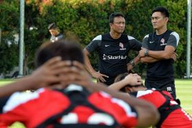 HARD AT WORK: LionsXII coach Fandi Ahmad (left) and assistant coach Nazri Nasir at a training session.