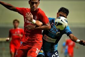 BETTER SHOW: Azmeer Yusof (in blue, vying for the ball with LionsXII striker Khairul Nizam last Saturday) and ATM put up a better show last night.