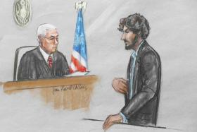A courtroom sketch shows Boston Marathon bomber Dzhokhar Tsarnaev speaking as U.S. District Judge George O'Toole looks on during his sentencing hearing in Boston, Massachusetts.