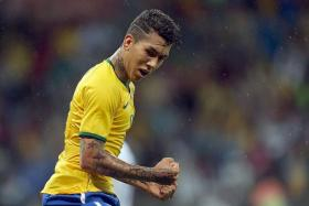 """""""When I arrived at Hoffenheim I could already play football, but I've developed physically, technically and tactically since then. Although I've now reached a good level, there's still more left to do. My own dissatisfaction is my biggest motivation."""" - Roberto Firmino (above)"""