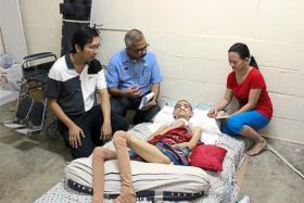Phoong Jun Woi, 17, was left paralysed after a hit-and-run accident. (From left) Jun Woi's former employer Lo Yn Loong, Johor Social Security Organization director Ismail Abi Hashim, Jun Woi, and his mother Suah Moy Yin.