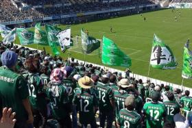 STRONG RELATIONSHIP: Fans and volunteers (above) create a great community bond and atmosphere at newly promoted J.League Division 1 debutants Matsumoto Yamaga.
