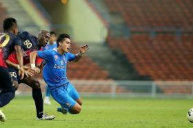 FELLED: LionsXII's Hafiz Abu Sujad falling after a challenge from behind by PDRM's Jaime Braganca.