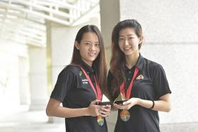 BEAUTY: Micky Lin (far left) and Charmaine Soh sporting the new earrings, a gift from Caraters Diamonds for winning the netball gold at the recent SEA Games.