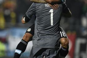 WHAT A FEELING: Carlos Tevez (above) celebrating with goalkeeper Sergio Romero after scoring the winning spot-kick.