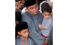 Mr Mohd Tarmizi Ismail with his younger son Alif Hazim.