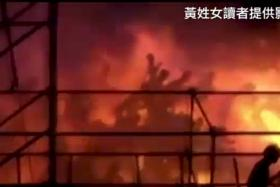 Silhouettes of people running from the blaze at the Formosa Fun Coast water park
