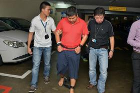 SUSPECTS: Myanmar national Phyo Min Naing and Singapore permanent resident Zaw Min Hlaing (above, in restraints) were taken to the alleged crime scene yesterday.