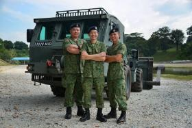 WINNERS: The 321st Battalion is the Best NS Combat Engineers Unit this year. Some of its key appointment holders include (from left) 2SG Quek Zhi Yuan (deputy chief clerk), Major (NS) Tan Chee Ming (commanding officer) and 2WO Poh Choon Beng (regimental sergeant major).