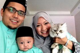 FAMILY: Mr Muhammad Al-Khair Salahuddin and his wife, Madam Masshitah Abdullah, with Aafaa in a photo taken during last year's Hari Raya Aidilfitri celebrations.