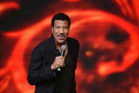 HOT: Lionel Richie stole the show on Sunday as the crowd sang along to his hit songs like Hello and Dancing On The Ceiling.