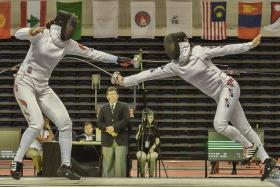 TAKE THAT: South Korea's Choi Eun Sook (right) scoring a point against China's Sun Yujie in the last round of the women's epee team final yesterday.