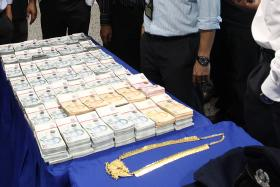 LOOT: The police recovered most of the money after officers arrested the robbers.