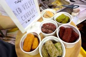 Red velvet and pandan churros are being sold at CHURROS by Bakes & Crafts at Geylang Serai Hari Raya Bazaar.