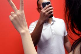 """POSE: Tan Choon Keap forced his victims to make the """"V"""" sign while he took pictures of them."""