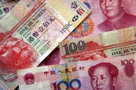 File photo of yuan notes and Hong Kong dollar notes.