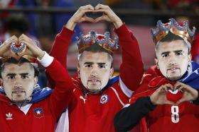 LONG LIVE THE KING: Chile fans don masks of their team's star player Arturo Vidal at the Copa America on home soil.