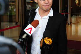 Blogger Roy Ngerng speaks to the media at the Supreme Court July 1