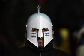 POWER PACKED: Argentina fans like the one below will be hoping to celebrate a Copa America triumph tomorrow morning.