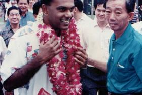 HAPPY DAYS: Mr Shanmugam in chong pang during his early days as an mp.