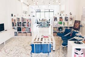COMFY: Digital storybook creator Paperplane's office has nailed the 'cool' workspace look, with its handmade pendant lights, coffee table upcycled from wooden pallets, down to its colourful floor.