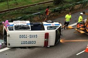 A private ambulance and a lorry collided near the Ayer Rajah Expressway (AYE) exit towards Alexandra Road yesterday evening.