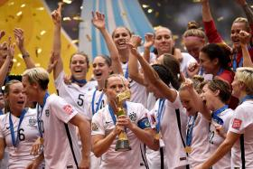 US players celebrating their world Cup win. They beat Japan 5-2 in the final of the Women's World Cup.