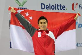 Quah Zheng Wen, seen here celebrating a medal win at the SEA Games, has been granted deferment to prepare for the 2016 Olympics.