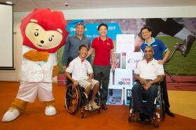 From left: Nila the mascot, Singapore Asean Para Games organising exco chairman Lim Teck Yin, Minister for Culture, Community and Youth Lawrence Wong, Deloitte Singapore CEO Philip Yuen, Singapore Disability Sports Council vice-president Raja Singh and para-sailor Jovin Tan.
