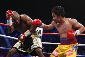 US boxer Floyd Mayweather Jr., (L) and Manny Pacquiao of the Philippines fight during their welterweight unification boxing bout at the MGM Grand Garden Arena in Las Vegas, Nevada on May 2, 2015.