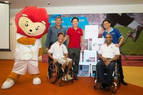 DELOITTE IS ONBOARD: (Clockwise from top left) Nila the mascot, Singapore Asean Para Games organising exco chairman Lim Teck Yin, Minister for Culture, Community and Youth Lawrence Wong, Deloitte Singapore CEO Philip Yuen, Singapore Disability Sports Council vice-president Raja Singh and para-sailor Jovin Tan at the unveiling of the Games' first official sponsor Deloitte at the Sports Hub Library yesterday.