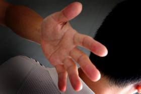 HIT? The police report alleged that the bank executive had slapped the boy's face, neck, shoulder and back.